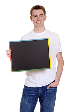 smiling teen boy with chalkboard photo