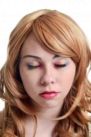 smirk: teen girl with rainbow eye shadow