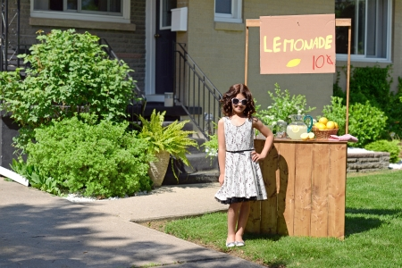 little girl with lemonade stand photo