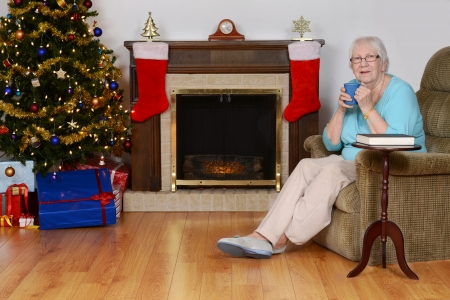 happy senior woman with coffee at christmas photo