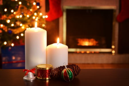 burning time: two christmas candles focus on flame shallow DOF