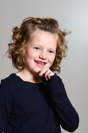 happy little girl with curly hair photo