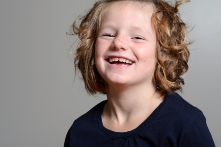laughing little girl portrait photo
