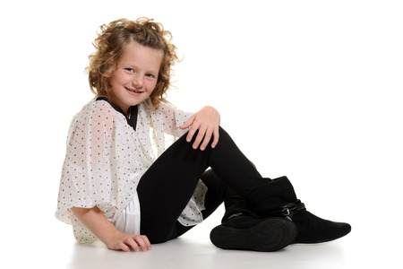 girl boots: little girl wearing boots sitting Stock Photo