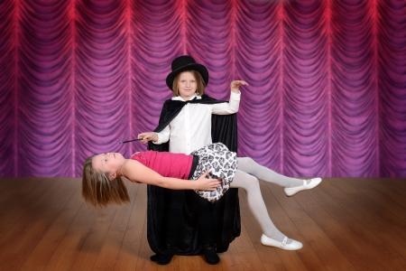 levitating: magician levitating assistant