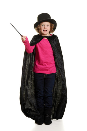 stovepipe hat: surprised girl dressed as magician motion blur on wand Stock Photo