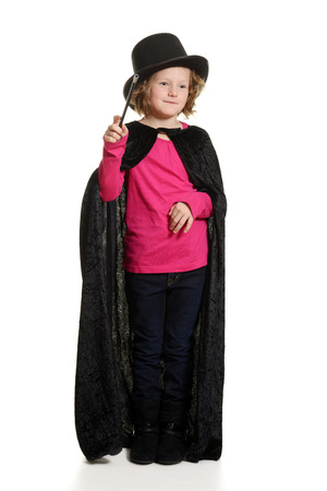 stovepipe hat: little girl magician doing magic Stock Photo