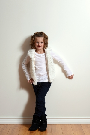 little girl wearing jeans and fur vest photo