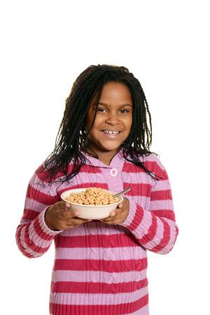 cornrows: black girl hold bowl of cereal Stock Photo