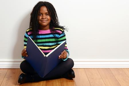 cornrows: happy child reading a book