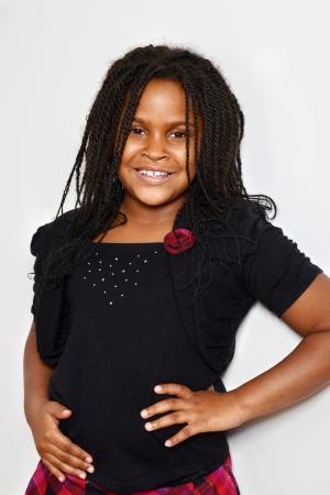 cornrows: portrait of a little jamaican girl