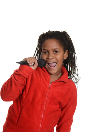 young jamaican girl with microphone 写真素材