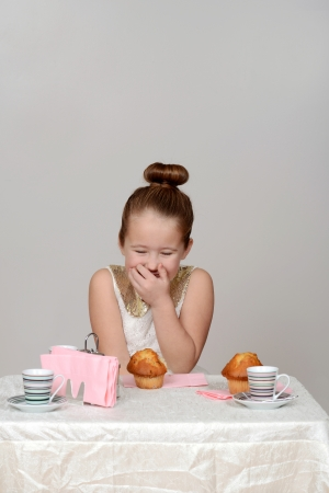 little girl giggling at tea party photo
