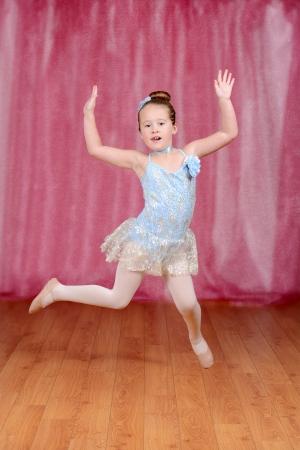 hopping: ballerina girl dancing and jumping