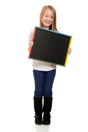 cute little girl holding blackboard photo