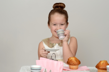 happy little girl tea party photo
