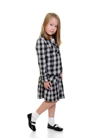 little girl wearing checkered dress photo