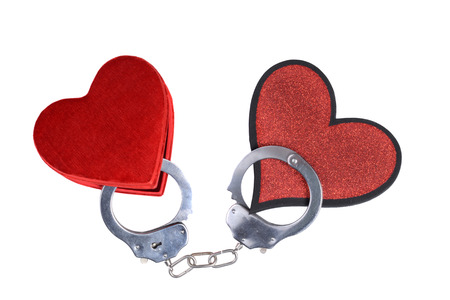 two hearts handcuffed together photo