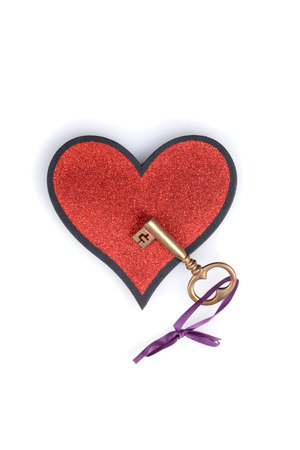 gold key on a heart photo