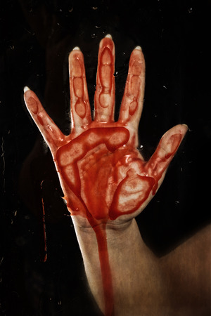 bloody hand on glass