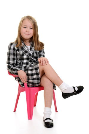 sit: little girl sitting in pink chair