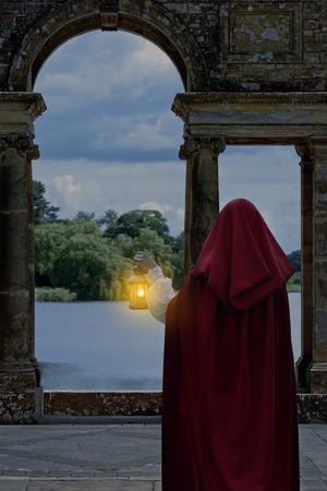 Moonlight lanterns: woman waiting by lake with lantern