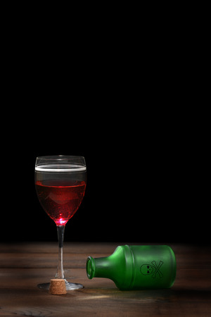 poisoned glass of red wine photo