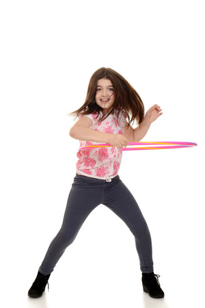 child doing hula hoop with motion blur Stock Photo