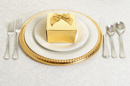gold and silver table setting photo