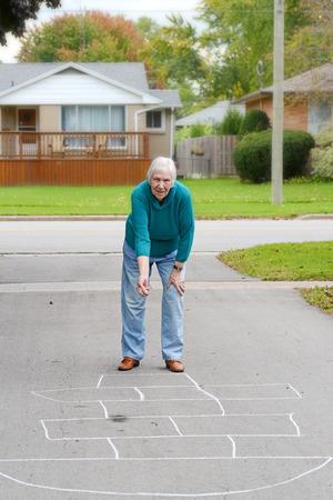senior woman playing childs game photo