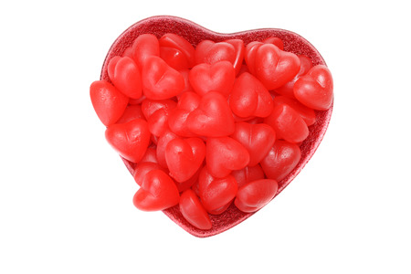 chewy: valentines red heart chewy candy in bowl Stock Photo