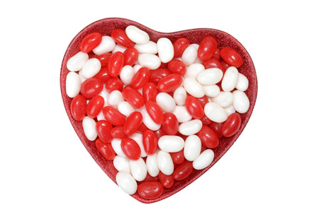 sugar bowl: valentines jelly bean in heart bowl Stock Photo