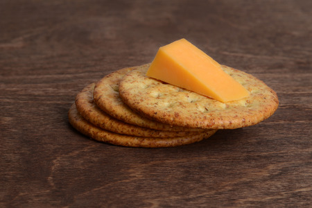 cheddar: wheat crackers with cheddar cheese Stock Photo