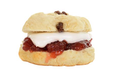 english tea: isolated english scone with cream and jam Stock Photo