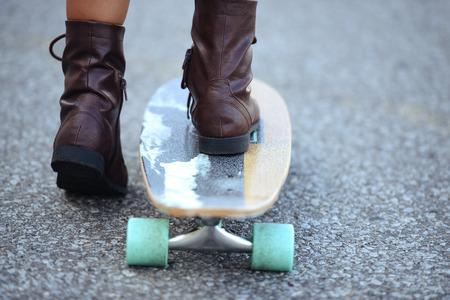 girl boots: closeup feet on skate board