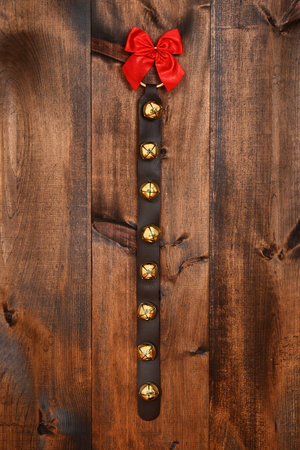 jingling: sleigh bells with red bow Stock Photo