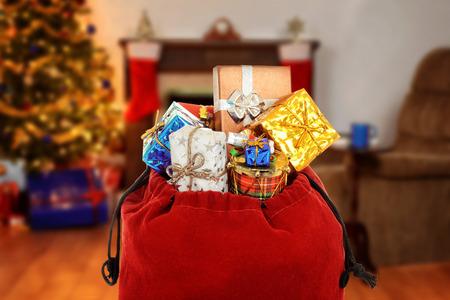 sackful: santa claus bag full of gifts Stock Photo