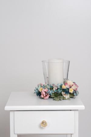 bedside: spring candle holder on table