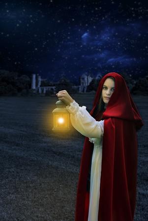 Moonlight lanterns: 1800 era woman at night with lantern