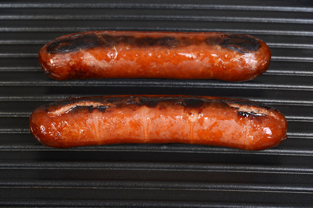 smoked: sausages cooking on a grill