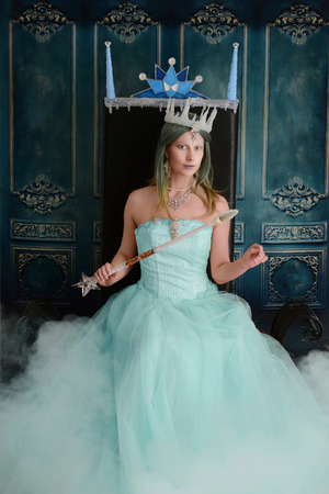 ice queen on her throne with mist Stock Photo