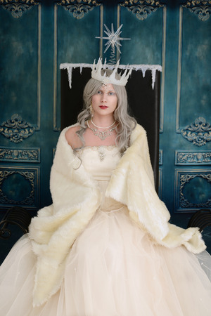 ice queen on throne with fur wrap Stock Photo