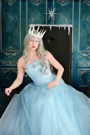 ice queen: ice queen leaning on throne