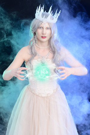 evil ice queen with ball of magic