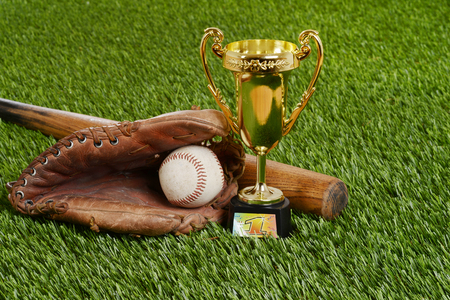 bat and ball: closeup baseball trophy with bat ball and glove