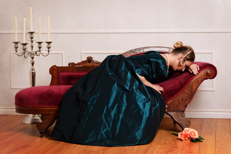 victorian woman crying on couch
