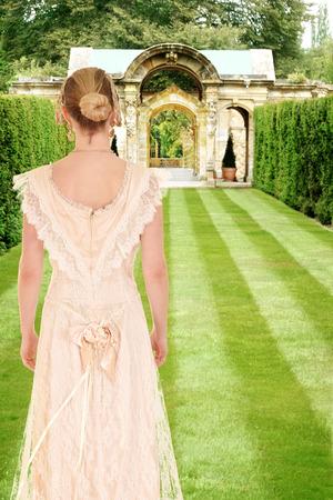 edwardian: victorian woman in formal garden