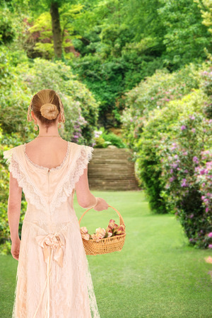 historical: victorian woman walking in garden with roses