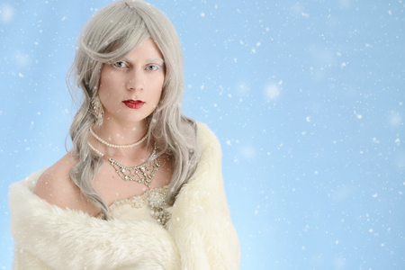 cloak: woman wearing fur cloak with snow Stock Photo