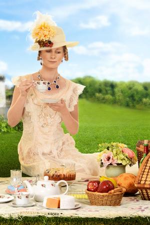 edwardian: vintage edwardian woman with hat at picnic